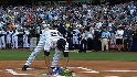 Mo lays flowers at the plate