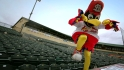 Fredbird throws his dancing shoes on and enjoys a little jig on the dugout.