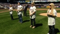 Carter family throws first pitch