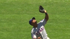 Beltre battles the sun to make a great catch