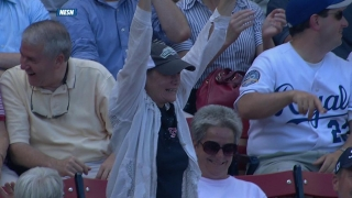 Fan is excited after foul ball catch