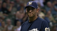 Brewers top Braves, complete climb to .500