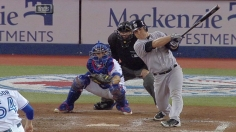 Lead remains one with Yanks' rout in Toronto