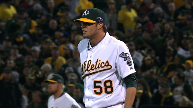 Scribner gives overworked A's bullpen a fresh arm