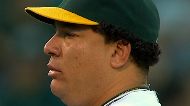 A's welcome Colon back into clubhouse