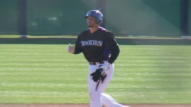 Rockies' pitching erratic in Helton's spring debut