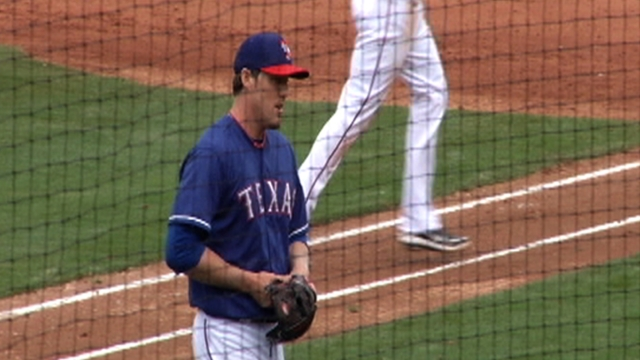 Nathan makes scoreless debut in Rangers' loss