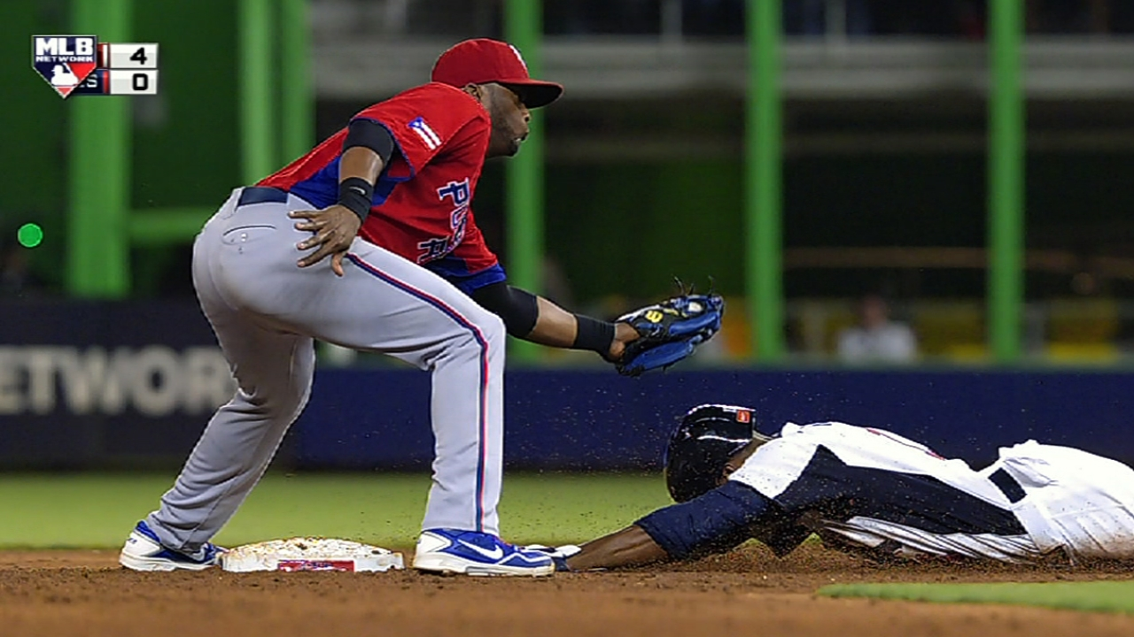 Yadi cuts down Rollins to halt USA's running game