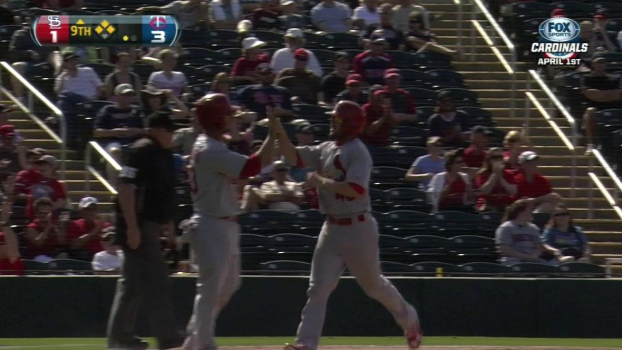 Adams' three RBIs lift Cards to victory against Twins