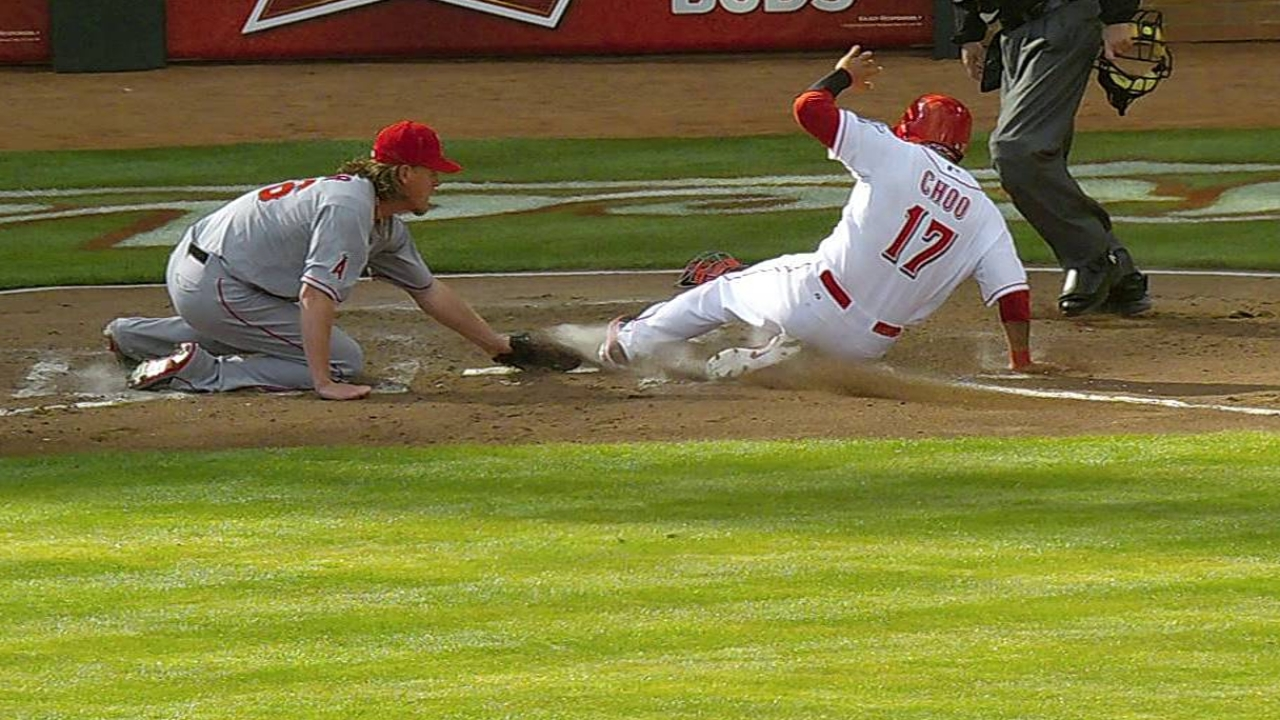 Choo does his part, but bats stifled as Reds fall in 13