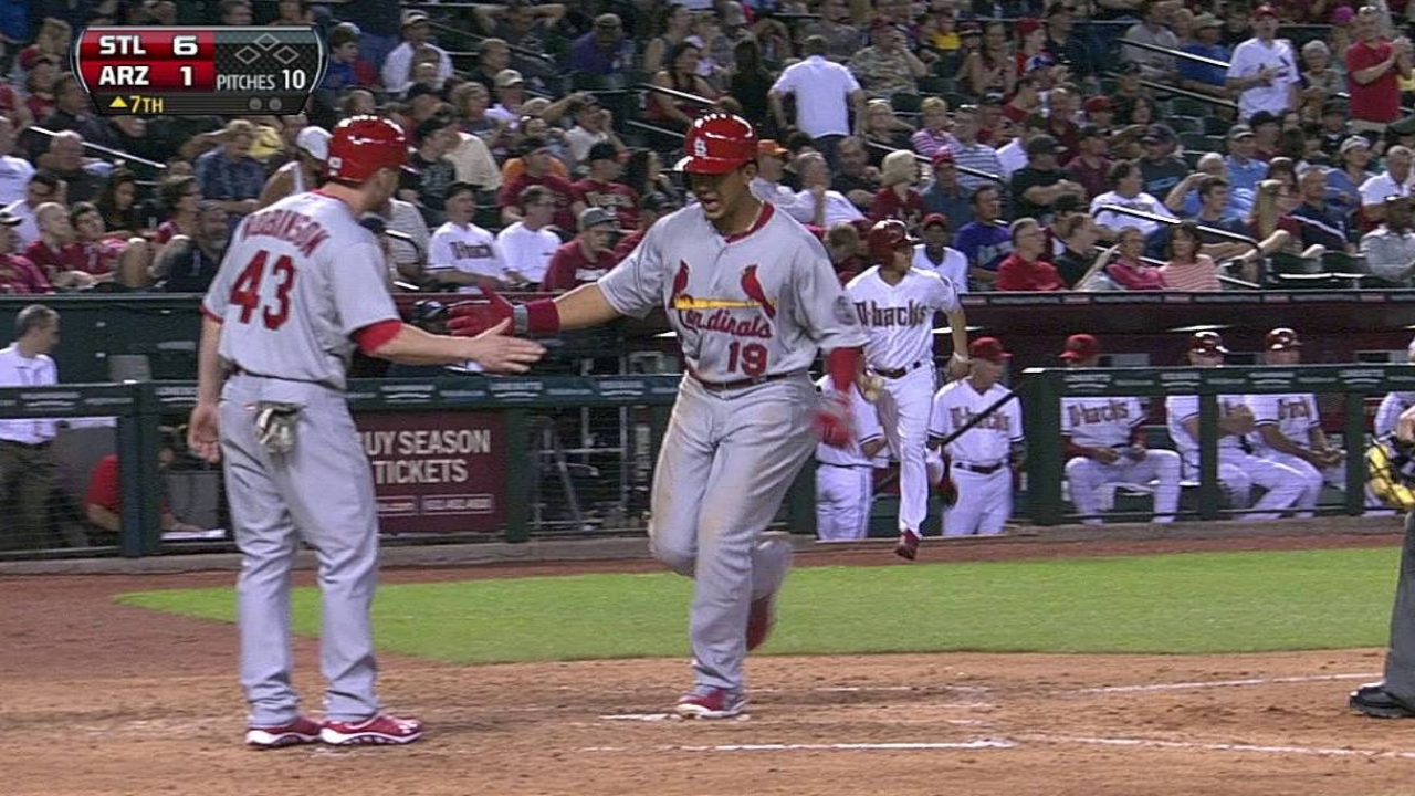 Cards overpower D-backs for victory No. 1
