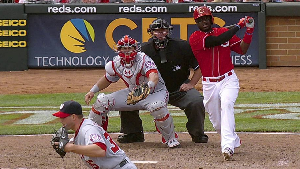 Reds miss opportunities in extra-innings loss