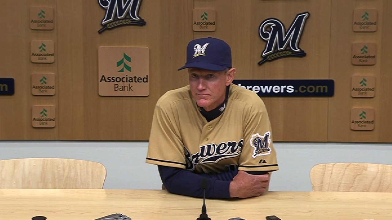 Axford struggles again as Brewers fall in extras