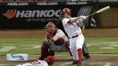Leake leads way on hill, with bat as Reds rout Phils