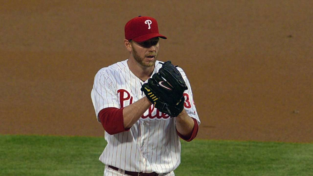 Offense breaks free to back Halladay's strong outing