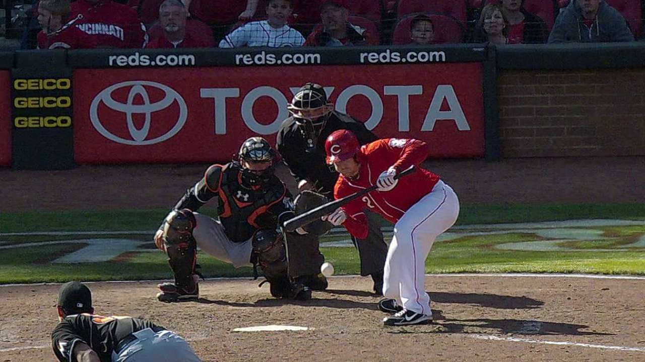 Cozart injures fingers on bunt; X-rays negative