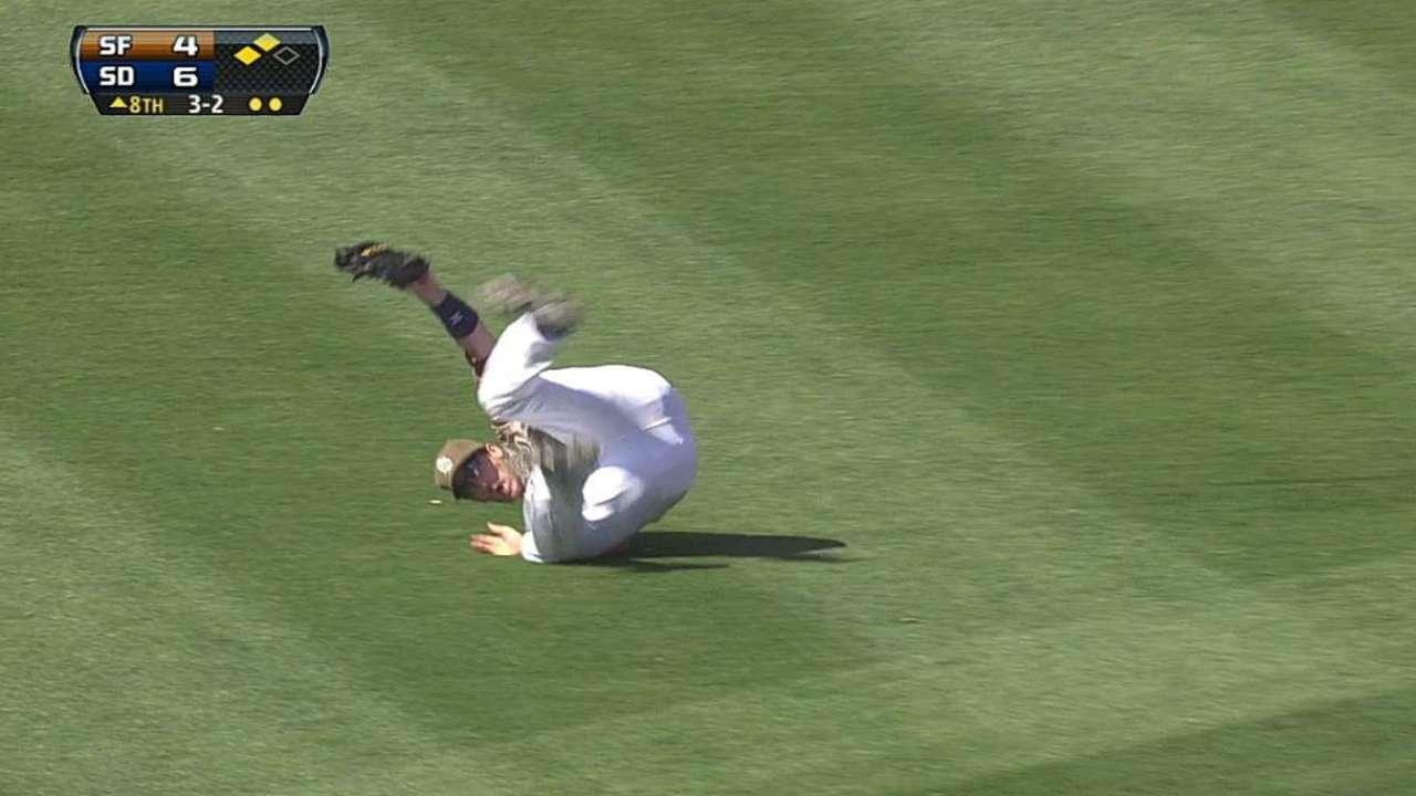 Padres hit homer trio, hang on for sweep