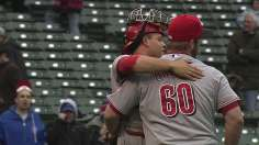 Reds break out of offensive funk, survive late rally