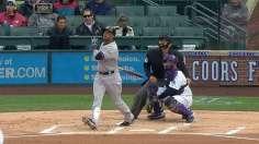 Cano, bullpen steer Yankees' wet win over Rockies