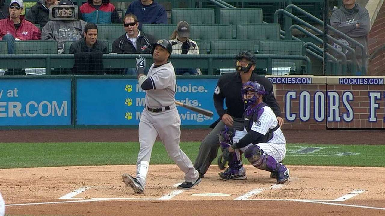 Cano, bullpen steer Yankees to win and first place