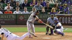 Giants dig out of six-run hole at Coors Field