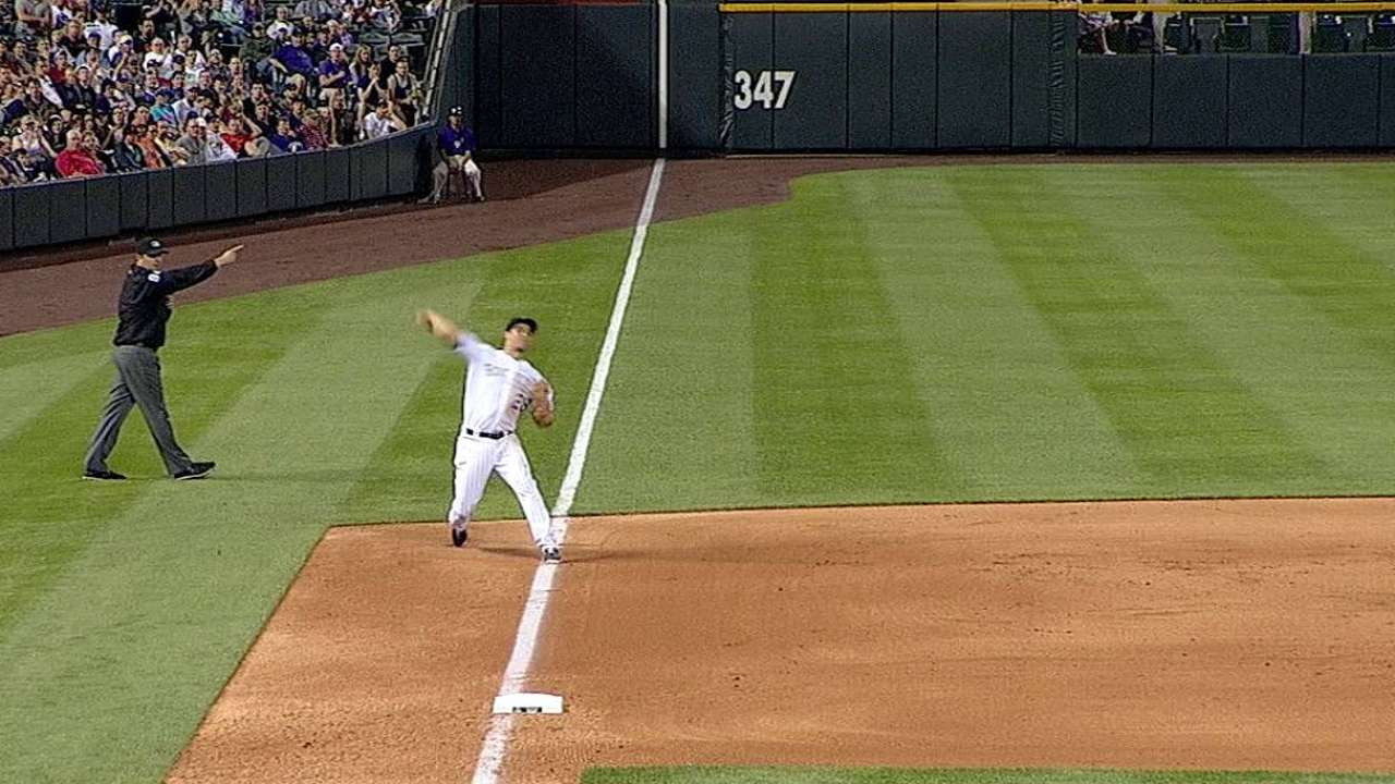 Rockies come out slugging, see lead slip away