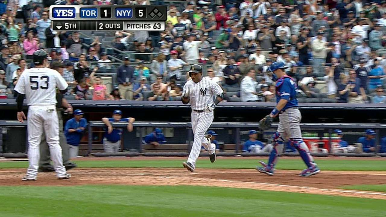 Cano's two homers help Yanks take care of Jays