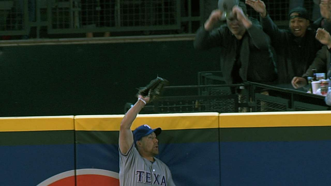 Rangers fall in 13 after Nathan's first blown save