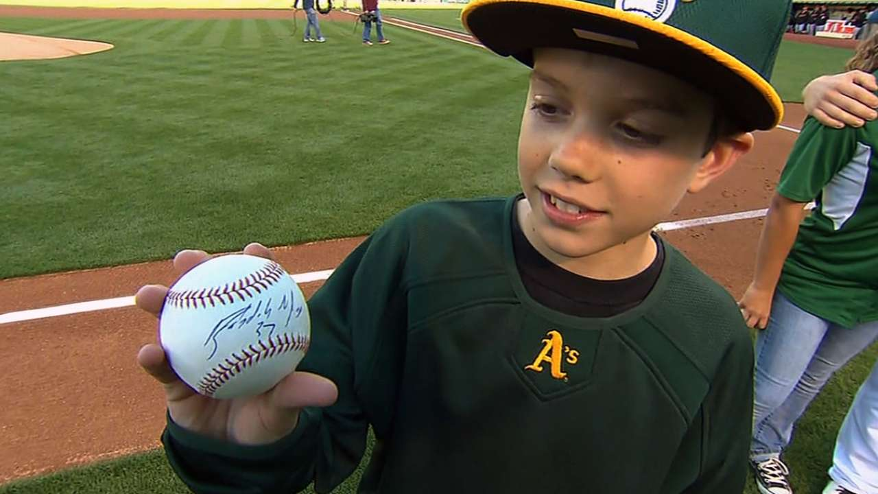 Bombing survivor throws out A's first pitch