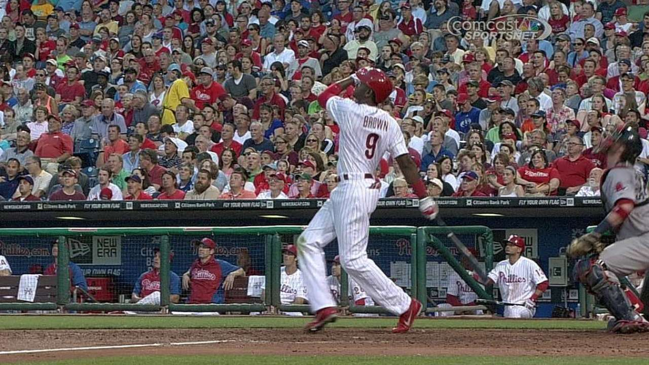 Phils swat four homers, move within game of .500