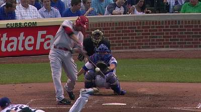 This goes to 11: Reds' power extends Wrigley streak