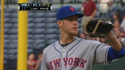 Mets strike late to help strong Wheeler win debut
