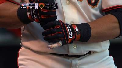 Scutaro back in action with splint on pinkie
