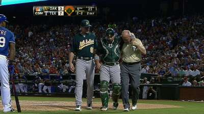 Norris exits after taking foul tip to groin