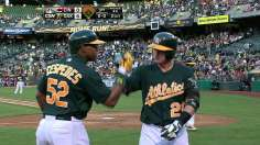 Early surge helps A's stave off Reds