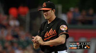 Timely hits, stellar relief carry O's over Yankees