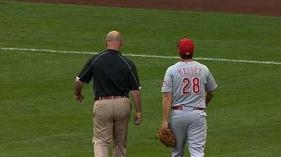 Heisey held out after getting plunked on arm