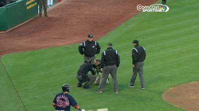 Home-plate umpire exits after getting hit in mask