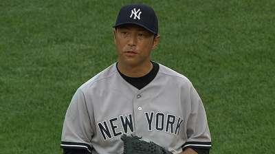 Kuroda, defense hold fort until Yanks put away Sox