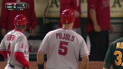 Pujols leaves club to have ailing foot examined