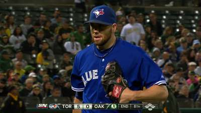 Delabar strikes out side on just nine pitches