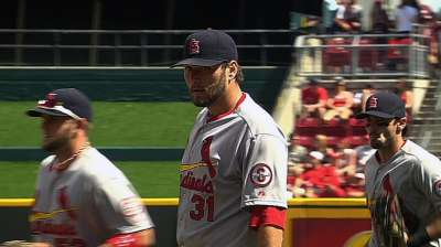 Carpenter busts slump as Cardinals bust up Reds