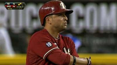 Prado's hot bat, D-backs' stellar defense fuel win