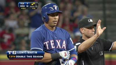 Rangers ride four-run eighth to win vs. Astros