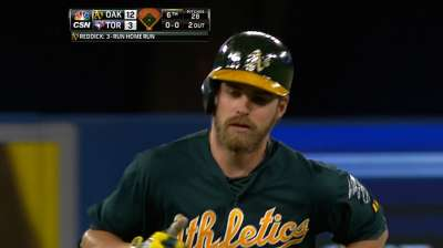 Reddick's three home runs help A's cruise in Canada