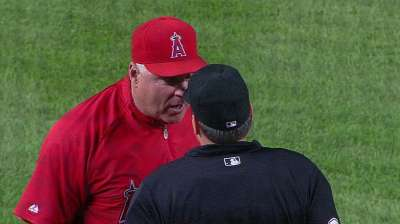Bullpen buckles after call goes against Angels