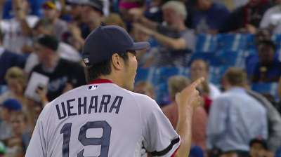 His '14 option vested, Uehara happy to be returning