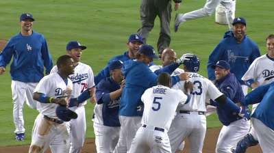 Early surge spurned by red-hot Dodgers