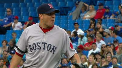 Peavy finds late trouble as Red Sox fall in Toronto