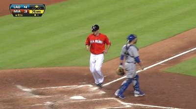 Marlins rally to tie, but fall on Puig's late homer